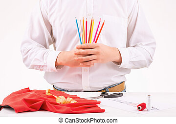 Tailor holding a set of colored pencils - Designer at work...
