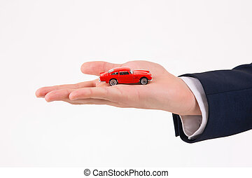 Little car model in male hand.