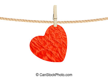 Crumpled paper heart hanging on rope on white background -...