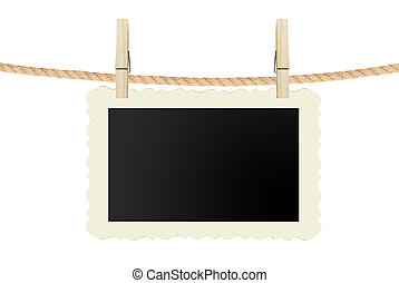 photo card hanging on rope isolated on white