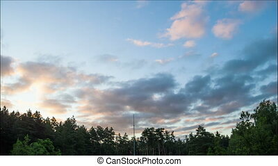 Sunrise, Clouds in a Sky Moving Above the Trees - Moon in...