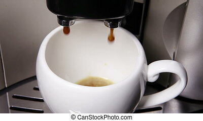 Coffee flows in a cup