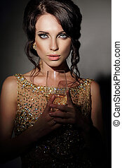 Woman with holding glass of wine.