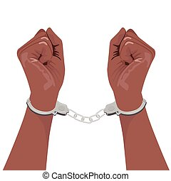 pair of african american hands in handcuffs - cropped...