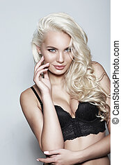 Fashion portrait of beautiful sexy blonde in a black...
