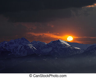 Remote mountains in sunset