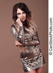 Beautiful woman in a shiny dress.
