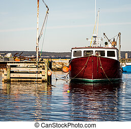 lobster fishing boat - Maroon lobster fishing boat at a...