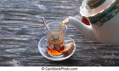 Pouring cup of tea slow motion - Pouring cup of tea from...