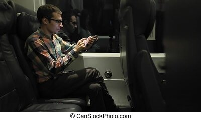 Man Using Smartphone in The Train