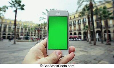 Man Using Smart Green Screen Phone Outdoors - Man Using...