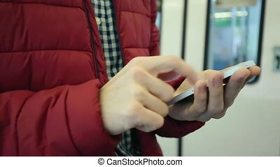 Man Uses His Mobile Phone In Subway Station - Caucasian Man...