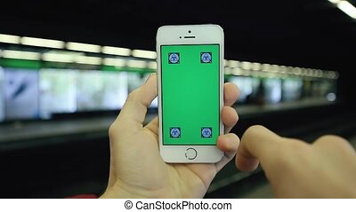 Man Uses Phone Green Screen In Subway Station - Close up...