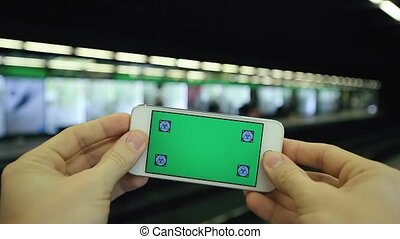 Green Screen Mobile Phone In Subway Station - Close up...