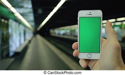 Man Uses His Phone Green Screen In Subway Station - Close up...
