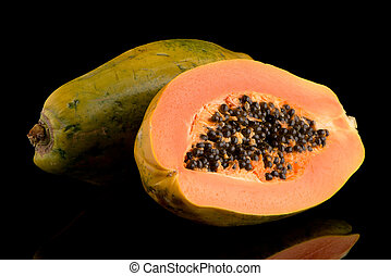 Fresh and tasty papaya on black background.
