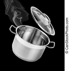 Cooking in the pot with lid isolated on black