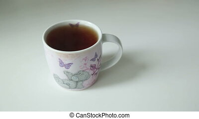 Hand Takes and Puts Cup of Tea - Womans Hand Takes and Puts...