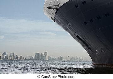 Panama city skyline. Large cruise ship entering panama city.