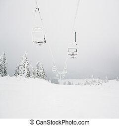 Chairlift, ski resort. Winter landscape. Carpathian Ukraine.