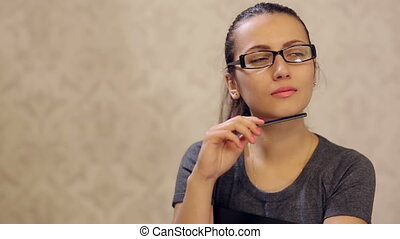 Woman Thinking With Pencil in Arm - cute woman thinking with...