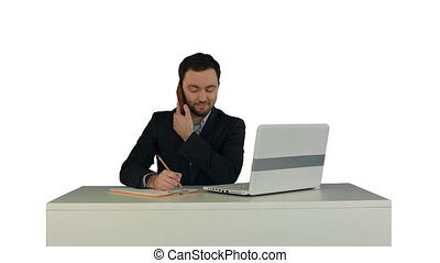 Young business man speaking on the phone in office. on white...