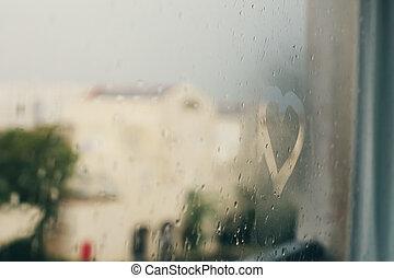 drawing hearts in wet window