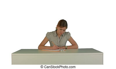Young girl sitting in classroom at lecture and listening teacher on white background isolated