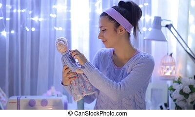 Woman with a Doll - woman looks at the doll with christmass...