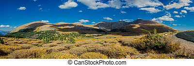 Panorama of Mountains and Road in Colorado - A panoramic...