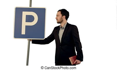 Man reading a book with parking sign on white background isolated