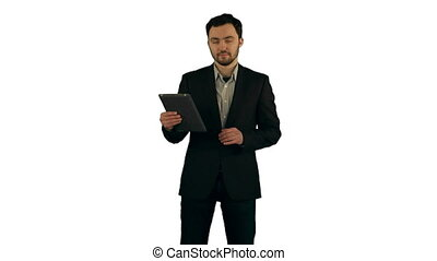 Businessman using his tablet on white background isolated