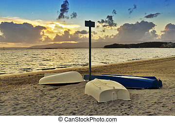 Overturned boats on the beach - Overturned boats on...