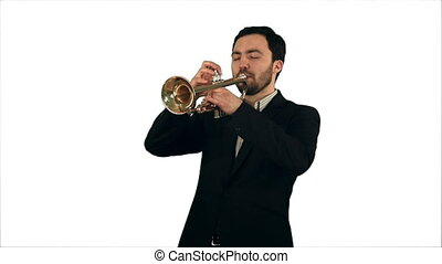 Young musician playing trumpet on white background isolated....