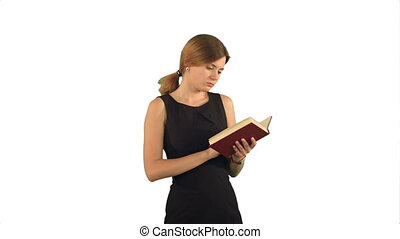 Young girl with book on laptop on white background isolated