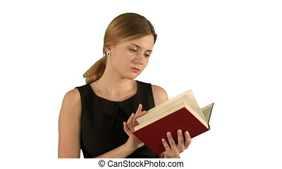 Young beautiful girl reading a book on laptop on white background isolated