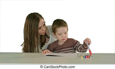 Happy family mother and child painting together on white background isolated