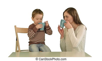 Son with his mother drinking tea on white background...