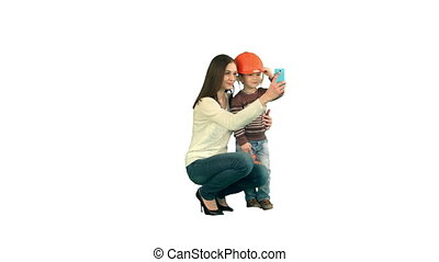 Boy taking a selfie with her mother on white background isolated