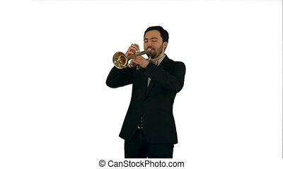 Portrait of a young man playing his Trumpet on white...
