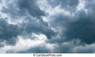 Storm clouds moving across the blue sky. - White, rain,...