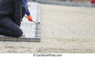 Worker puts paving