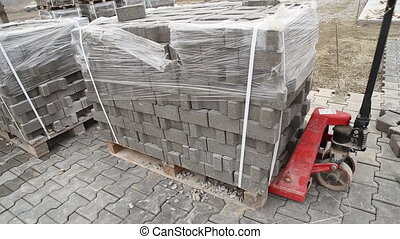 handcart carrying heavy paving slabs