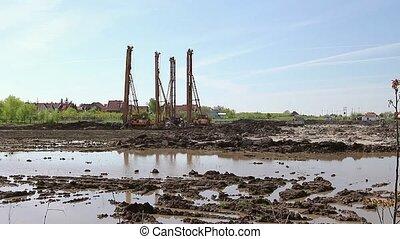 Pile driving machine - Landscape view on construction site...