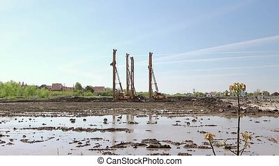 Pile driving machine - Landscape view on construction site...