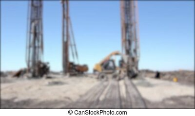 Blurry view on construction site - Blurred view on...