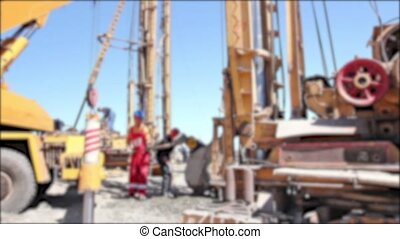 Blurred view construction site. - Workers with shovels are...
