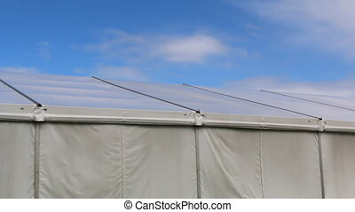 Big tent and blue sky - Wind moving canvas of the big social...