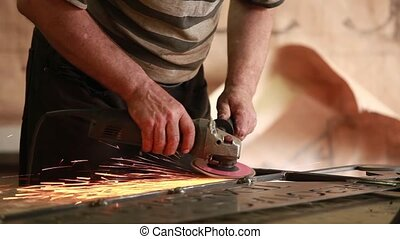 Hand sanding sander - Worker using grinder close to