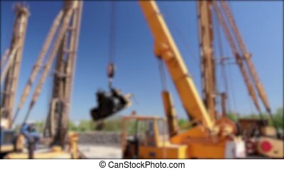 Blurred mobile crane - Mobile crane is operating and lifting...